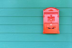 Red mailbox with green wood, vintage style